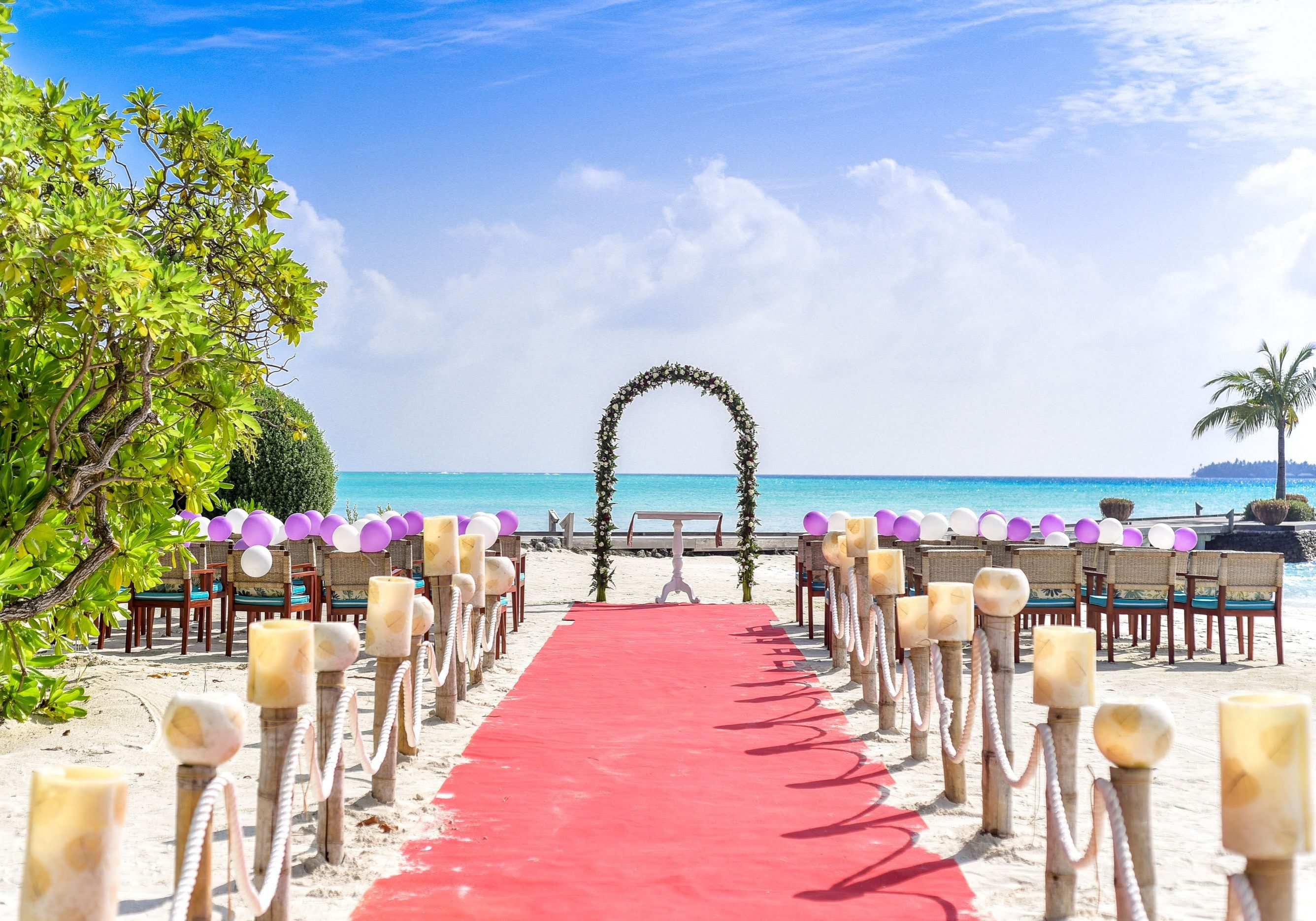 beach-wedding-event-under-white-clouds-and-clear-sky-during-169211